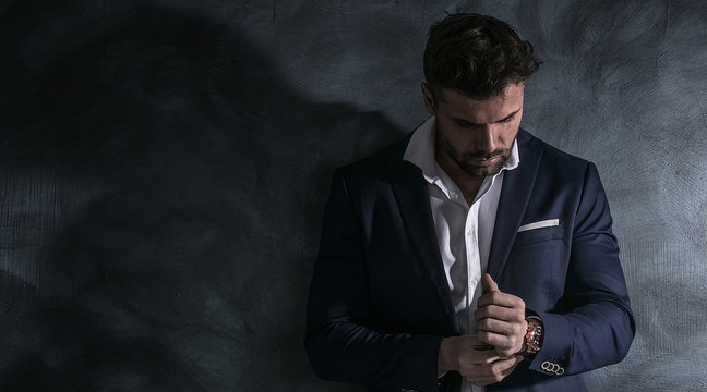 Portrait of handsome man in elegant suit.