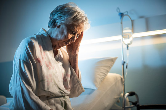 Lonely senior patient with headache