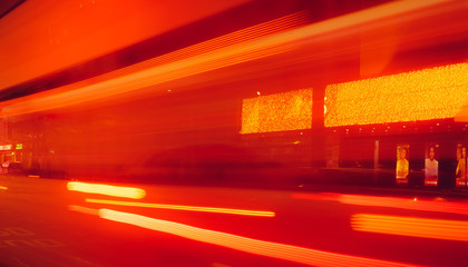 City street in the night with blurred fast speed car light. Red and yellow light at the rod beside the building. Night light abstract background. Blurred motion of light on the road. Wall mural