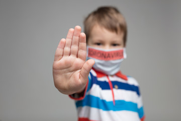 Young child wearing respiratory mask as a prevention against the Coronavirus Covid-19