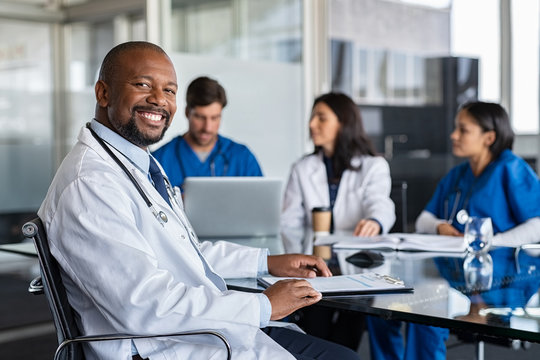Successful mature doctor at hospital meeting