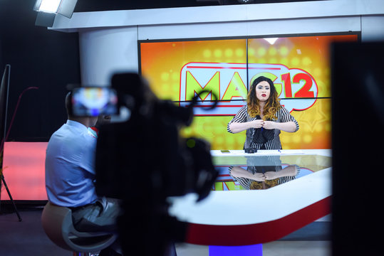 Line Banty, an albino presenter of the Mag 12 show on 3TV channel, is seen during her live show on the screen of the control room of the private TV station in Ouagadougou