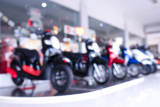 Abstract blur motorcycle on showroom sales area in Asia