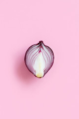 Purple onion on a light pink background