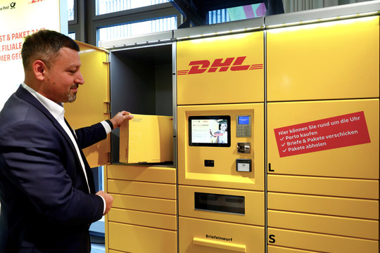 An employee shows the functions of an automated and internet connected package delivery station with ability to receive payments by app, in Berlin