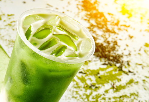 Cold drink with ice cubes and matcha