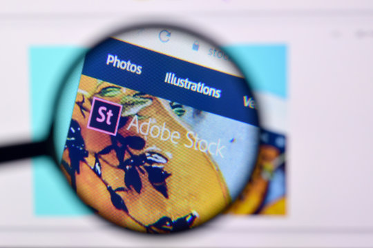 Homepage of adobe stock website on the display of PC, url - stock.adobe.com.