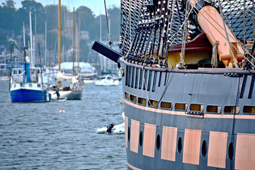 Tall ship detail with view to Newport harbor