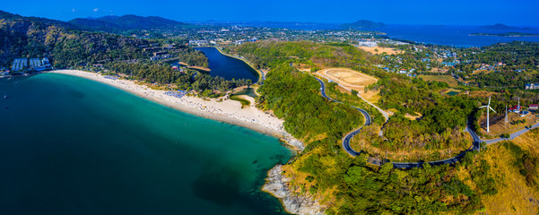 Fototapete - Aerial panorama of the island of Phuket during sunny day. Area of the Nai Harn beach and wind generator. Thailand
