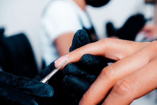 Classic manicure for men's hands. Cutting of cuticles with scissors.