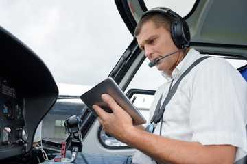 a pilot holding a tablet Wall mural