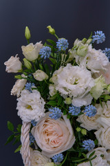 Tuinposter Lelie Bouquet. Composition of fresh, delicate flowers on a dark background.