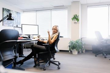 Portrait confident creative businesswoman working at desk in office