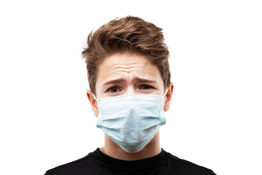 Teenager boy wearing respiratory protective medical mask
