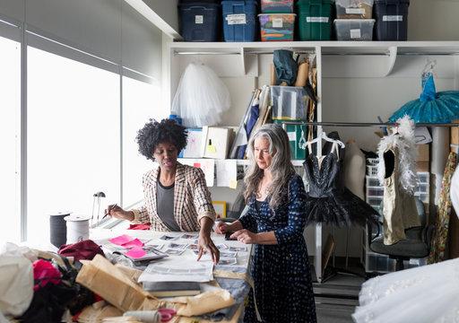 Female fashion designers meeting in studio