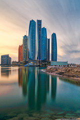 Photo sur Toile Abou Dabi Jumeirah at Etihad Towers , Abu Dhabi Skyline at sunset