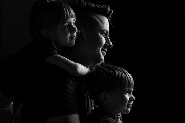 caucasian Family Portrait in Black and White. Father daughter and son. family with two children. similarity of children