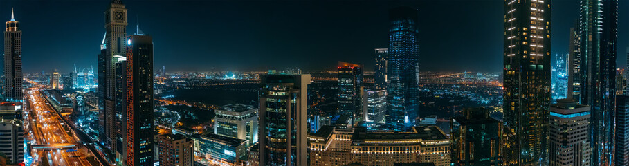 Dubai skyline downtown at night panorama, UAE. View from above of skyscrapers buildings.