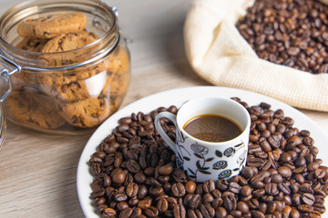 Wall Murals Cafe Coffee beans on plate and in coffee bag with cookie jar