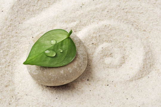 Sand and stone texture background with line pattern. Minimal zen meditation garden. Concept for yoga, spa wellness or buddhism and mindfulness