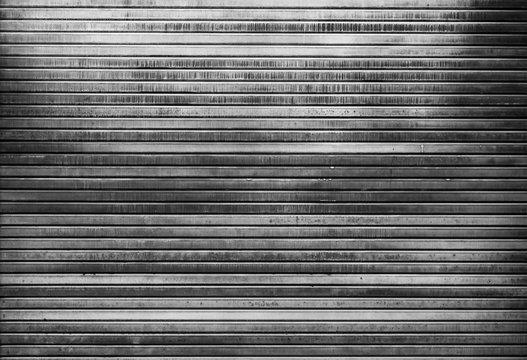 Detail of a metal doorway in black and white