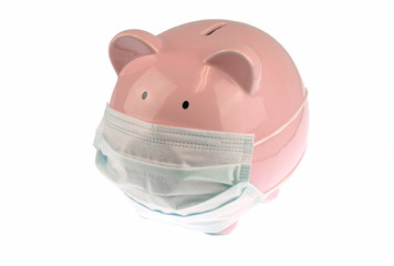 Pink piggy bank with mask isolated on white background