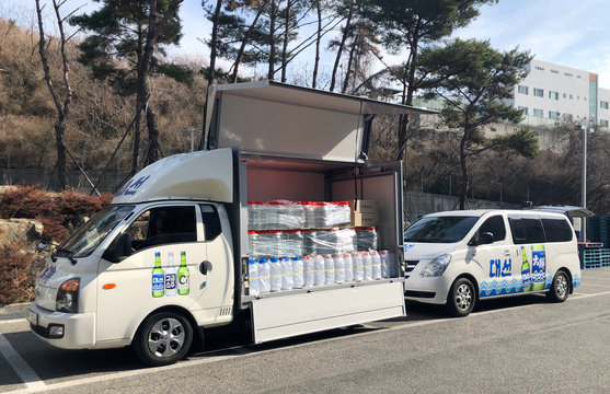 Vehicles carrying ethanol which is originally an ingredient for South Korean liquor Soju and will be used as disinfectant arrive in Daegu