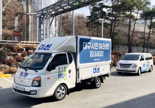 Vehicles carrying ethanol which is originally an ingredient for South Korean liquor Soju and will be used as a disinfectant arrive in Daegu