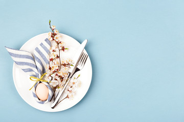 Easter table setting with egg in napkin Easter Bunny.