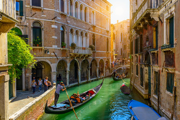 Keuken foto achterwand Gondolas Narrow canal with gondola and bridge in Venice, Italy. Architecture and landmark of Venice. Cozy cityscape of Venice.