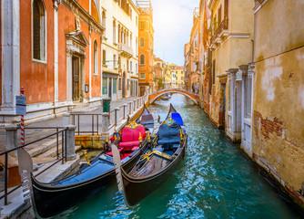 Aluminium Prints Venice Narrow canal with gondola and bridge in Venice, Italy. Architecture and landmark of Venice. Cozy cityscape of Venice.