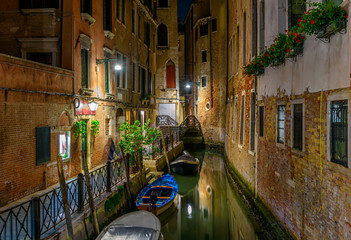 Wall Mural - Narrow canal with bridge in Venice, Italy. Architecture and landmark of Venice. Night cozy cityscape of Venice.