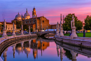 Wall Mural - View of canal with statues on square Prato della Valle and Basilica Santa Giustina in Padova (Padua), Veneto, Italy. Sunset cityscape of Padua.