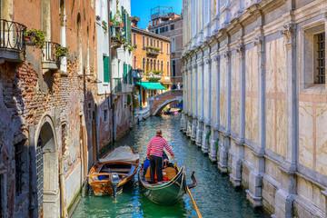 Foto op Aluminium Gondolas Narrow canal with gondola and bridge in Venice, Italy. Architecture and landmark of Venice. Cozy cityscape of Venice.