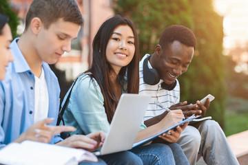 Happy Teens International Students Studying Together Outdoors, Enjoying University Life