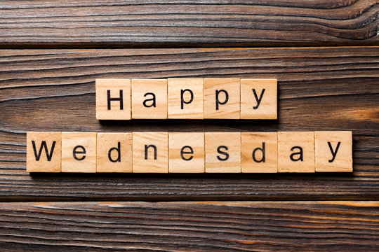 Happy wednesday word written on wood block. Happy wednesday text on wooden table for your desing, concept