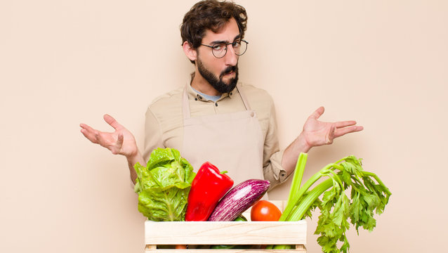 green grocery man feeling clueless and confused, having no idea, absolutely puzzled with a dumb or foolish look