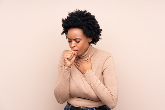 African american woman over isolated background is suffering with cough and feeling bad