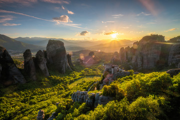 Foto op Plexiglas Zwart Sunset over monasteries of Meteora
