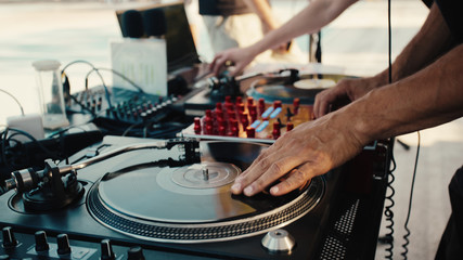 Dj and turntable with record. Summer party