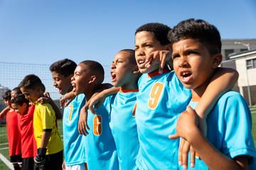 Aligned soccer teams singing