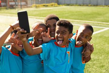 Soccer team taking selfies together