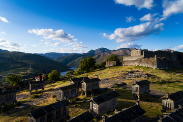 Aerial drone photo of the traditional village of Lindoso, with the old castle and the granaries, in the Minho Region, Portugal