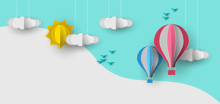 Cute papercut sky landscape background with white copy space. Hot air balloon, sun and clouds made in realistic paper craft art or origami style for baby nursery, children design.