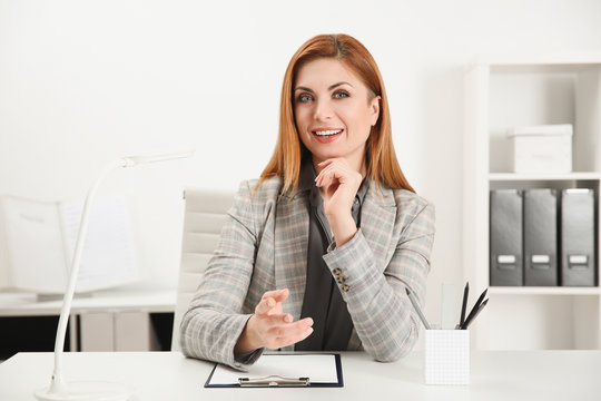 Happy woman using video chat in modern office, view from web camera