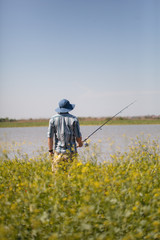 Stock photo of a man fishing on a summer day