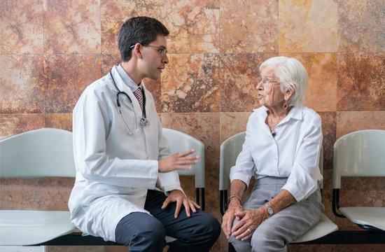 doctor talking to elderly woman