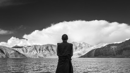 Tibetan Monk By The Lake In A Mountains