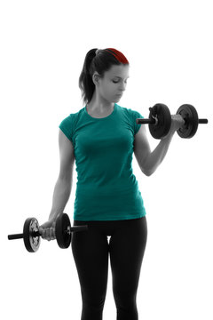 Sporty young woman doing bicep curls with dumbbells