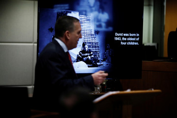 Deputy District Attorney John Lewin shows a photo of Robert Durst as a young man during opening statements in the murder trial in Los Angeles